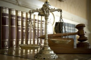 14205686-symbol-of-law-and-justice-law-and-justice-concept-focus-on-the-scales