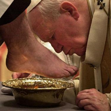 Pope John Pope II kisses the foot of an unidentified clergyman during the Holy Thursday Mass rite of the washing feet in St. Peter's Basilica at the Vatican, Thursday, April 20, 2000. The rite evokes Jesus' washing of the apostles' feet the day before his crucifixion, and is mantained by the Church as a symbol of humility. The pontiff celebrated the Holy Thursday Mass that marks the start of a four-day Easter celebrations. (AP Photo/Massimo Sambucetti, Pool)
